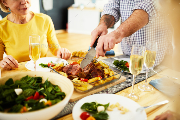 Cutting cooked meat for dinner - Stock Photo - Images