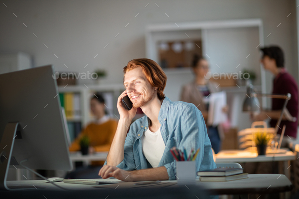 Man by computer - Stock Photo - Images