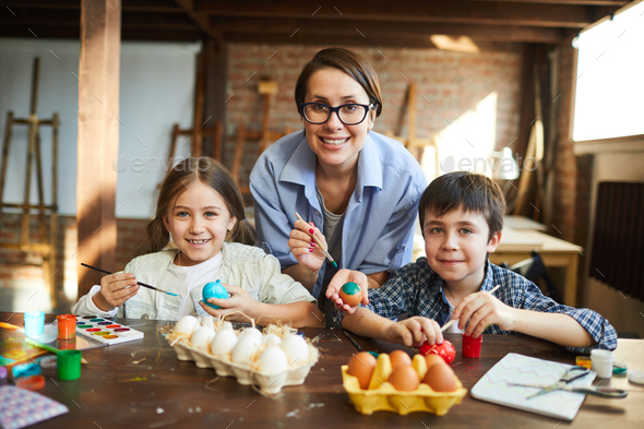 Happy Family Painting Easter Eggs - Stock Photo - Images