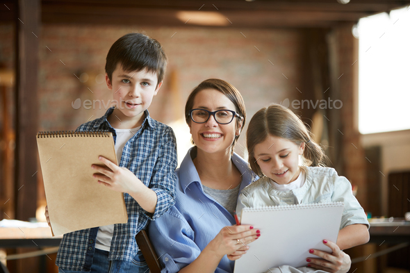 Mother Posing with Two Kids - Stock Photo - Images