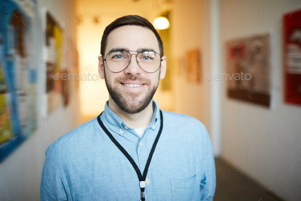 Smiling Bearded Man in Art Gallery - Stock Photo - Images