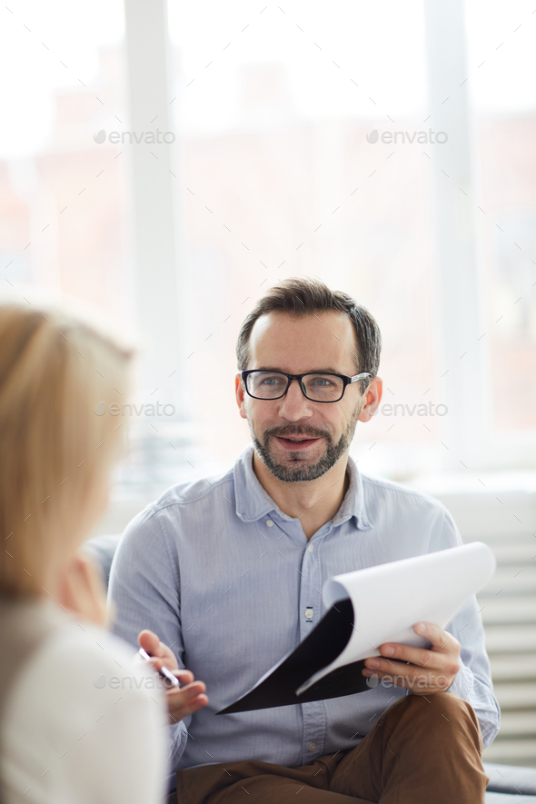 Discussing ways of solving problem - Stock Photo - Images