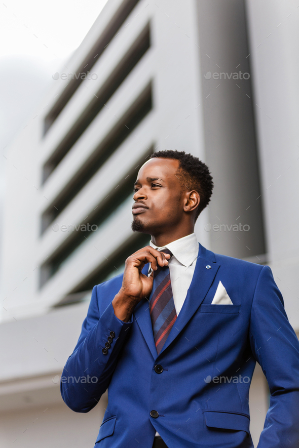 Outdoor standing portrait of a black African American business m - Stock Photo - Images