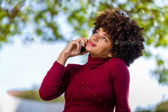 Outdoor portrait of a Young black African American young woman s - Stock Photo - Images