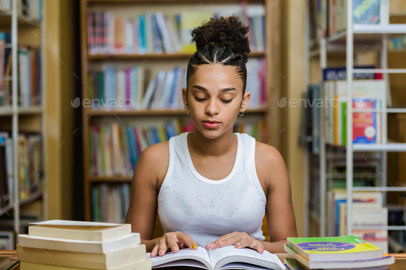 Black african american young girl student studying at the school - Stock Photo - Images