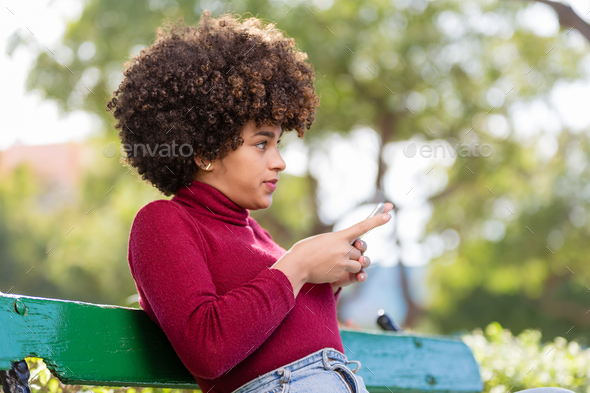 Outdoor portrait of a Young black African American young woman t - Stock Photo - Images