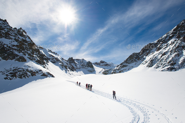 Group of climbers roped to the summit - Stock Photo - Images
