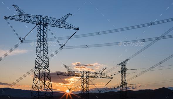 power transmission pylon in sunrise - Stock Photo - Images
