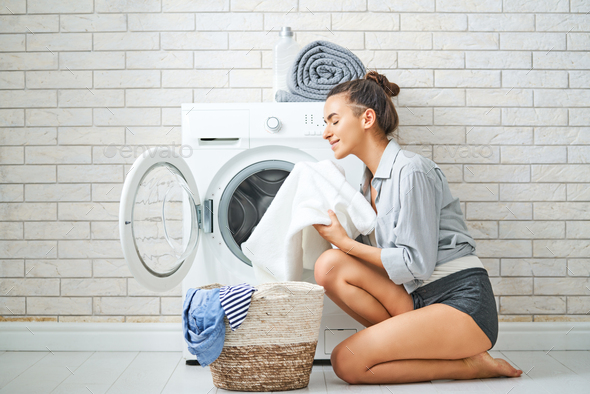 woman is doing laundry - Stock Photo - Images