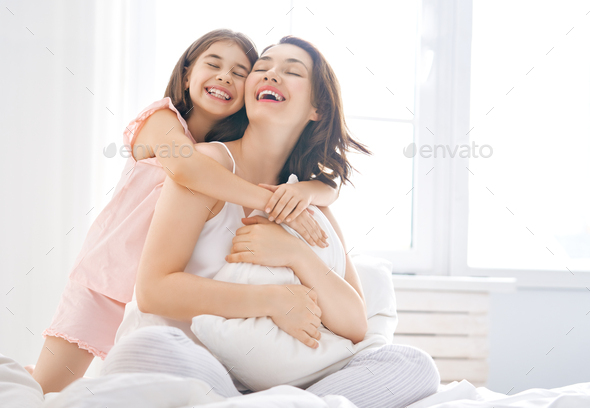girl and her mother enjoy sunny morning - Stock Photo - Images