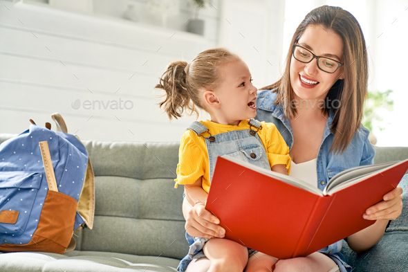 mother and daughter are reading a book. - Stock Photo - Images