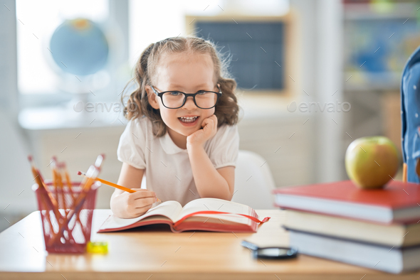 Kid is learning in class - Stock Photo - Images