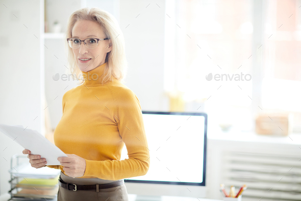 Mature Businesswoman Standing Behind Glass - Stock Photo - Images