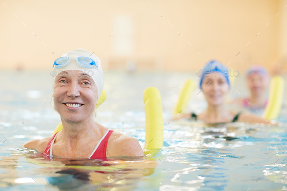 Happy Women Working Out in Water - Stock Photo - Images