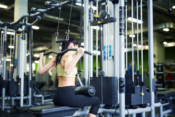Girl exercising in gym - Stock Photo - Images