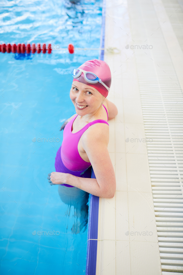 Happy Woman in Swimming Pool - Stock Photo - Images