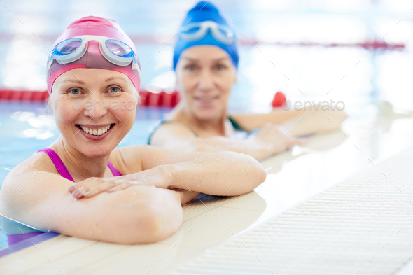 Two Adult Women in Swimming Pool - Stock Photo - Images