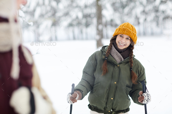 Smiling Woman Skiing in Forest - Stock Photo - Images