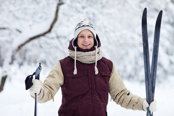 Happy Man Skiing in Forest - Stock Photo - Images