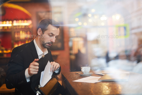 Businessman leaving Cafe - Stock Photo - Images