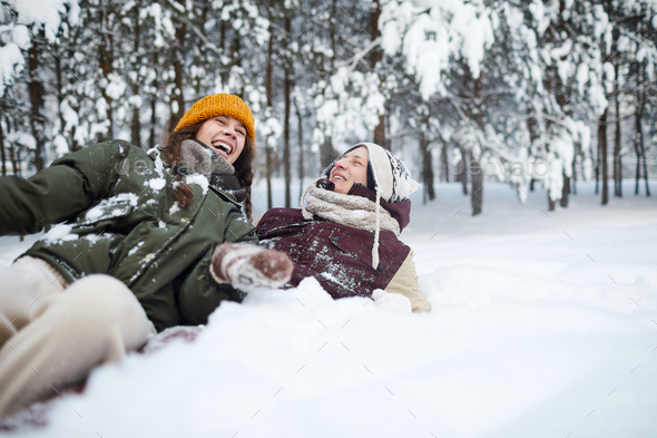 Couple Playing in Snow - Stock Photo - Images