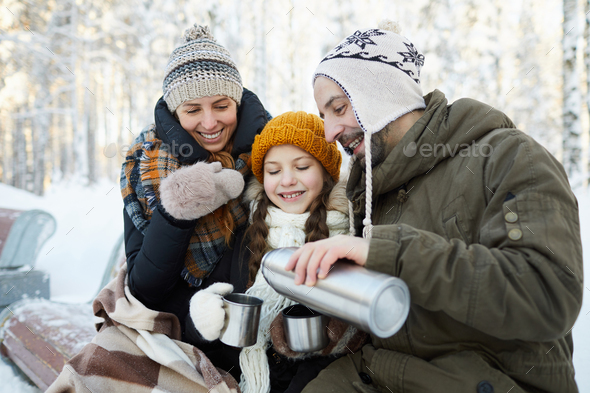 Family Drinking Cocoa in Park - Stock Photo - Images