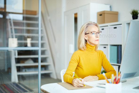 Mature Businesswoman at Work - Stock Photo - Images