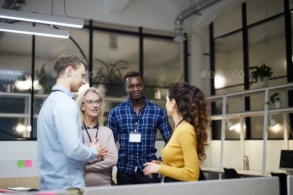 Multi-ethnic business team discussing presentation - Stock Photo - Images