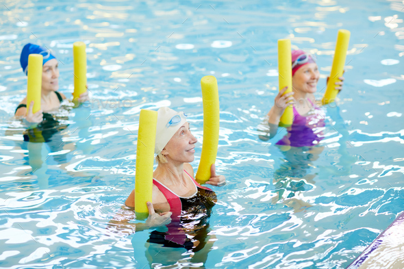 Mature Women Working Out in Water - Stock Photo - Images