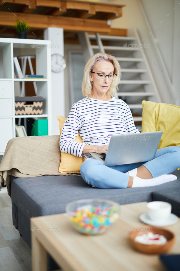 Contemporary Adult Woman Working at Home - Stock Photo - Images