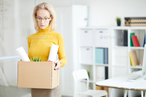Mature Businesswoman Leaving Work - Stock Photo - Images