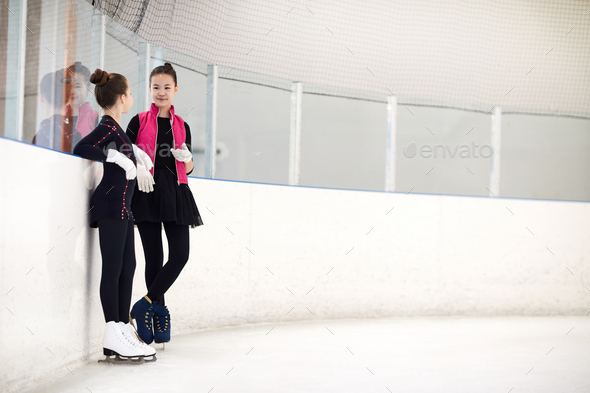 Two Figure Skaters Chatting - Stock Photo - Images