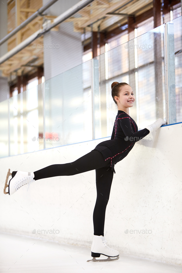 Figure Skater Stretching Legs - Stock Photo - Images