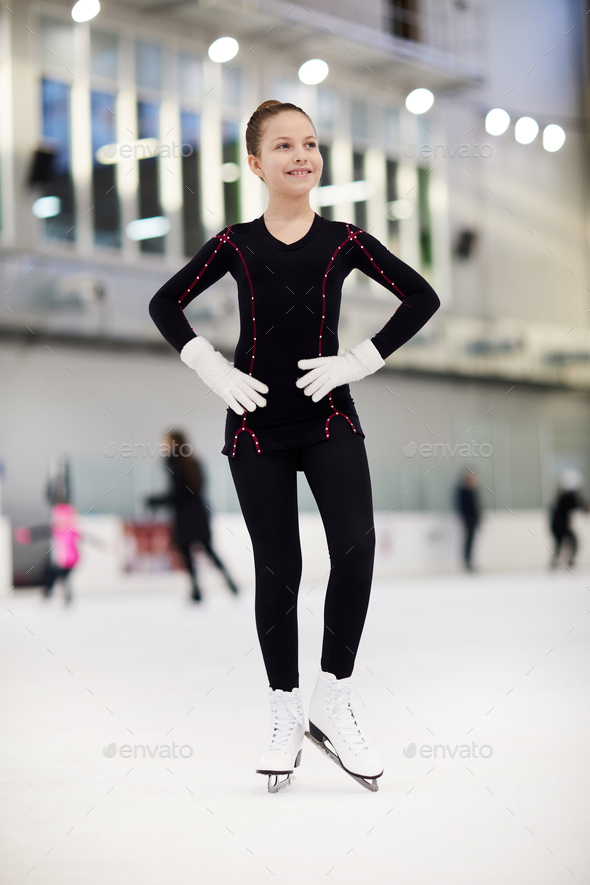 Happy Girl Figure Skating - Stock Photo - Images