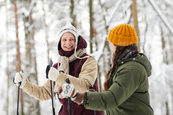 Cheerful Couple Skiing in Forest - Stock Photo - Images