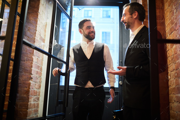 Two Business people Entering Restaurant - Stock Photo - Images