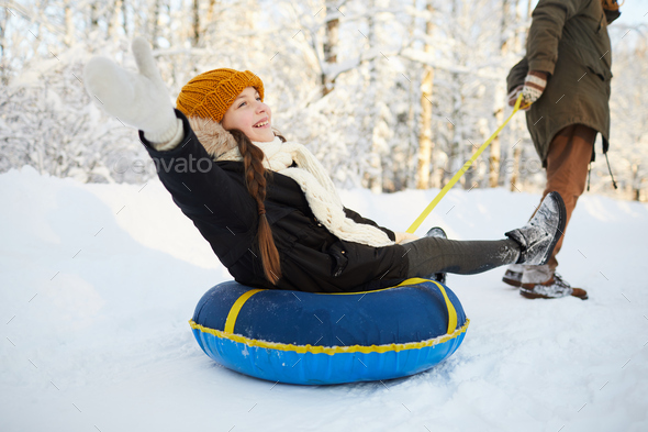 Girl Enjoying Sleigh Ride - Stock Photo - Images