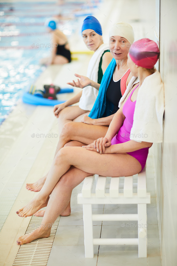Senior Women Resting by Pool - Stock Photo - Images