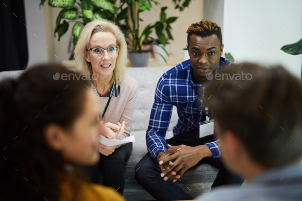 Multi-ethnic colleagues participating in discussion - Stock Photo - Images