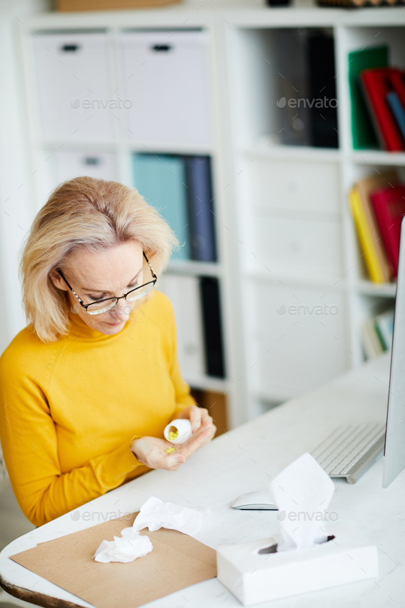 Woman Taking Pills at Workplace - Stock Photo - Images