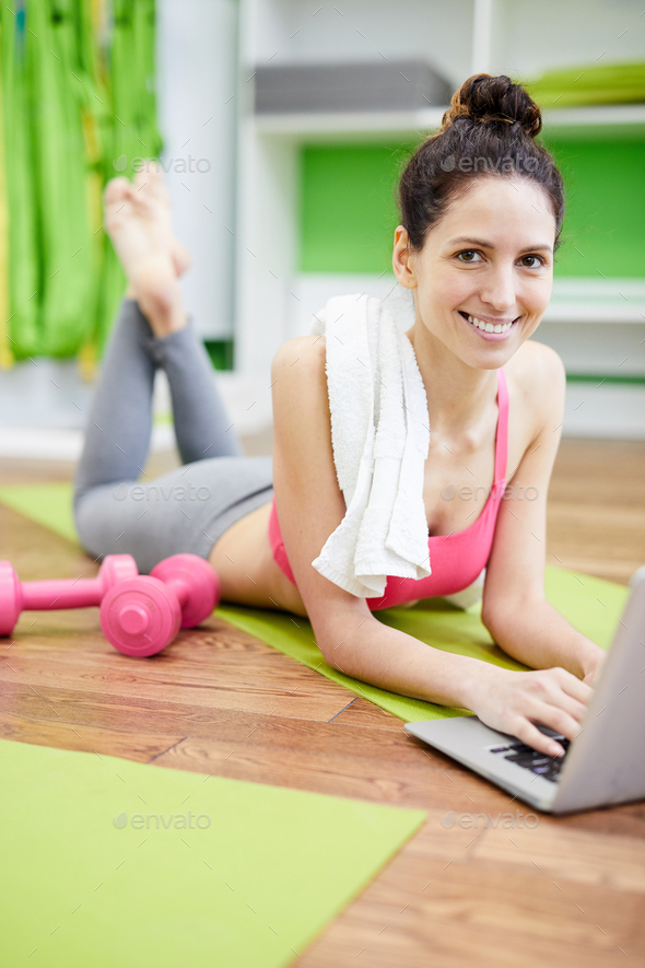 Smiling Woman in Health Club - Stock Photo - Images