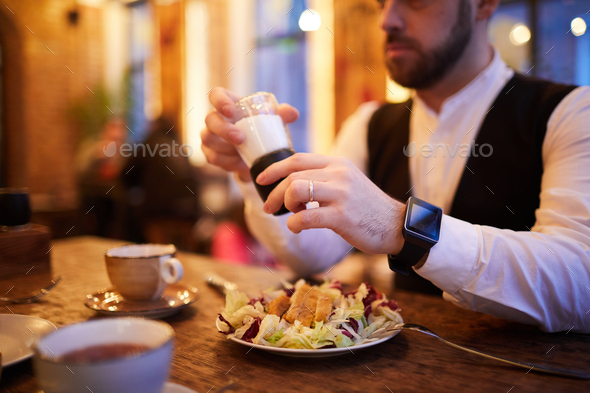 Businessman Eating in Restaurant - Stock Photo - Images