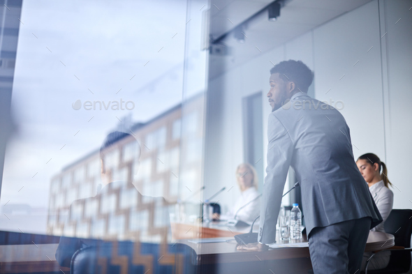 Speaker by table - Stock Photo - Images