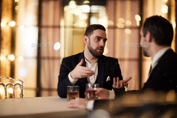 Business People Discussing Work in Restaurant - Stock Photo - Images