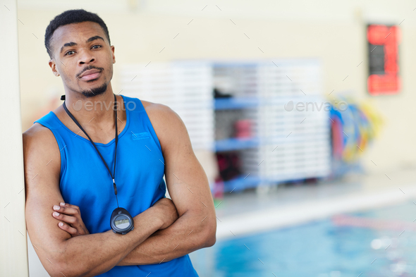 Male Fitness Instructor in Swimming Pool - Stock Photo - Images