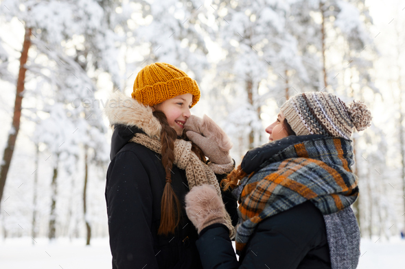 Mother and Child in Winter - Stock Photo - Images