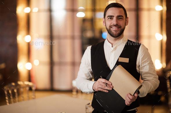 Profesional Waiter in Restaurant - Stock Photo - Images