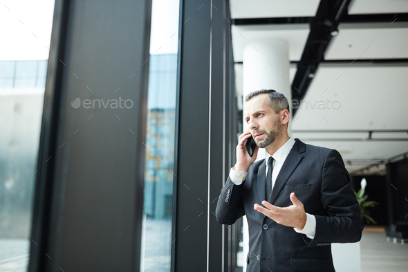 Phoning in airport - Stock Photo - Images