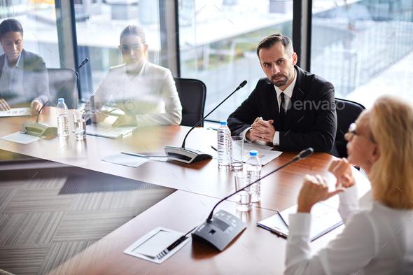 Delegates listening to speaker - Stock Photo - Images