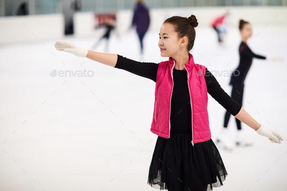 Asian Girl Figure Skating - Stock Photo - Images